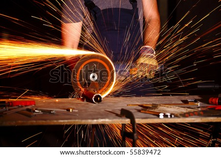 detail of electric grinder tool in action - stock photo