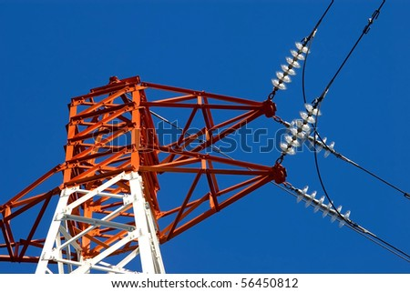 Detail of electric insulators from a high voltage power pylon - stock photo