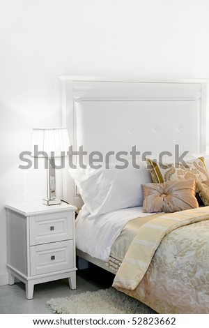 Detail of elegant cozy white bedroom nightstand - stock photo