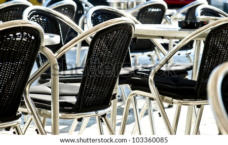 detail of empty chairs in coffee bar