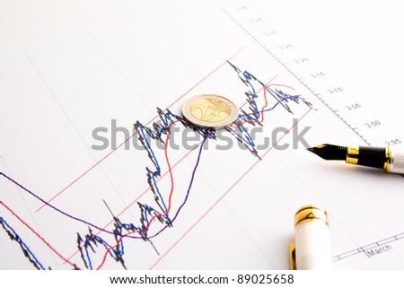 detail of euro coin on financial spread btp bund chart - stock photo