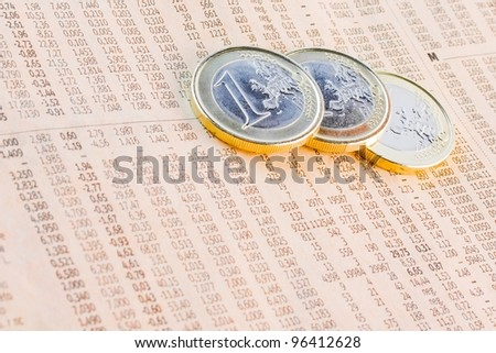 detail of euro coins on the financial newspaper - stock photo