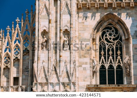 Detail of facade of Milan Cathedral or Duomo di Milano is the cathedral church of Milan, Italy. - stock photo
