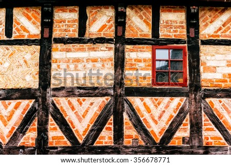 Detail of facade of old house made of wood and bricks in historical district of Malmoe in Sweden - stock photo