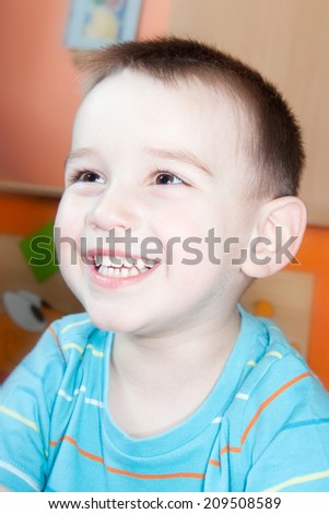 detail of face boy at home - stock photo