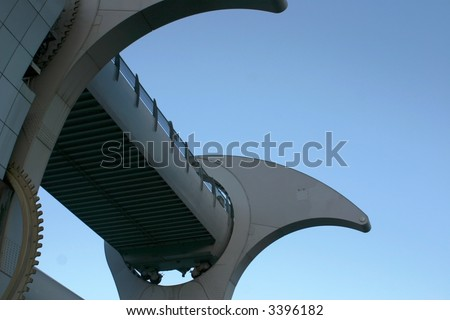 Detail of Falkirk Wheel (rotating boat lift for canal boats between the Forth and Clyde Canal and the Union Canal, Scotland, UK, against blue sky. - stock photo