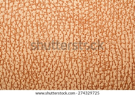 Detail of false leather surface with brown pattern. - stock photo