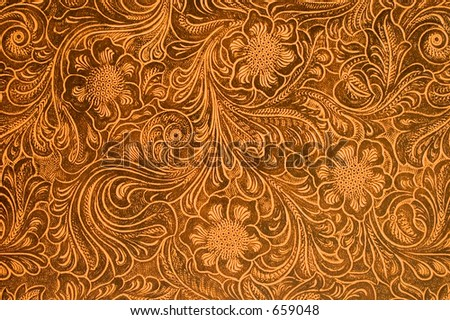 Detail of fancy tooled leather cover.  Good for backgrounds, menus, buttons, etc. - stock photo