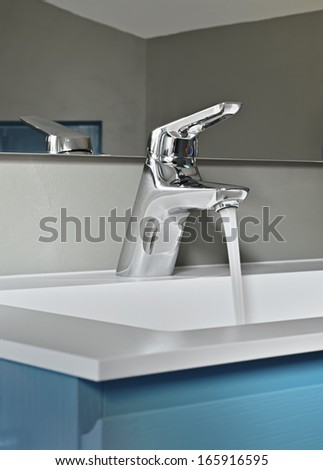detail of faucet in a modern bathroom