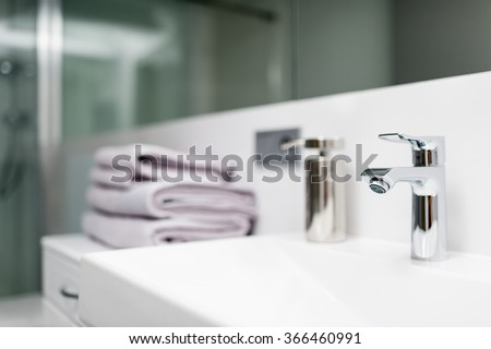 Detail of faucet in the white bathroom