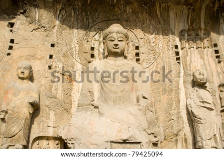 Detail of FengXianSi temple Grottoe in Longmen Grottoes. Longmen Grottoes with Buddha's figures are Starting with the Northern Wei Dynasty in 493 AD. It is one of the four notable grottoes in China. - stock photo