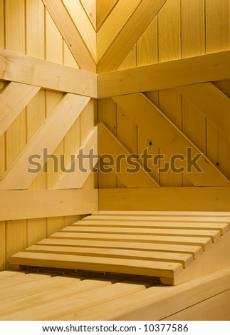 Detail of Finnish sauna. Wooden bench and pillow in it. - stock photo