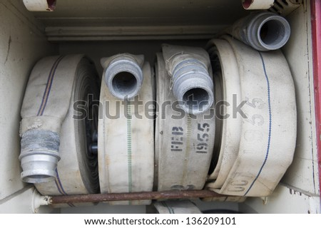 Detail of fire hoses - stock photo