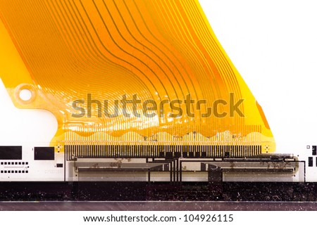 Detail of flexed printed circuit board (FPC) connected to LCD isolated on white