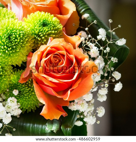 Detail of flower bouquet with orange rose