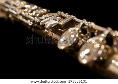 Detail of flutes on a black background - stock photo
