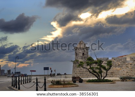 "Detail of fort ""La Punta"" and skyline in havana bay entrance - stock photo"