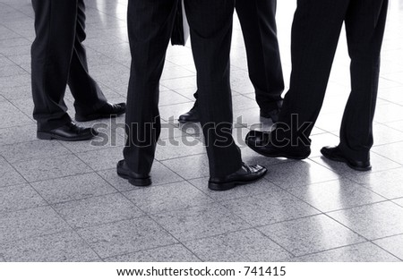 Detail of four businessmen in the circle - stock photo