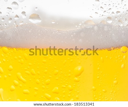 detail of fresh beer with drops for background - stock photo