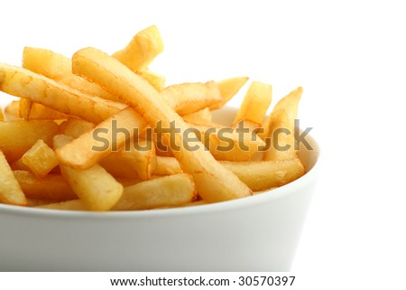 Detail of fresh golden french fries in ceramic bowl isolated on white - stock photo