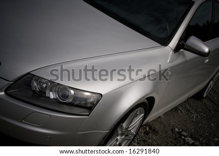 Detail of front light and bonnet of a luxury car - stock photo