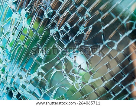 Detail of glass window car cracked by an accident - stock photo