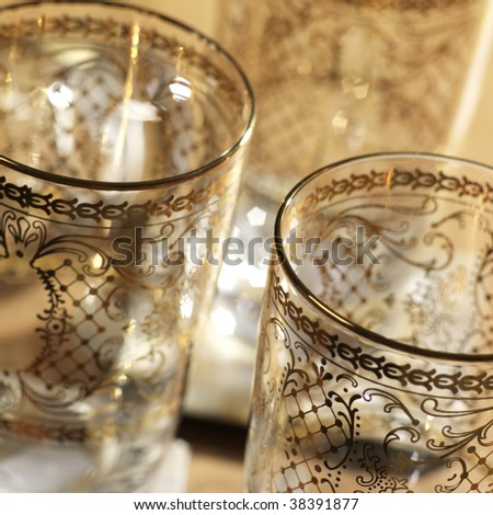 Detail of glasses decorated with gold - stock photo