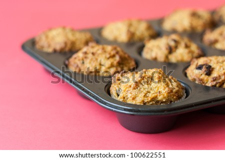 Detail of gluten free muffins on roasting pan - stock photo