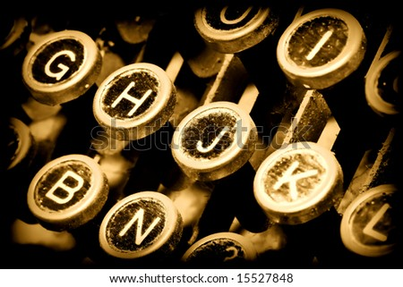 detail of golden typewriter, close up on keys - stock photo