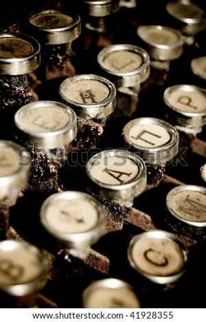 detail of golden typewriter, close up on keys - stock photo