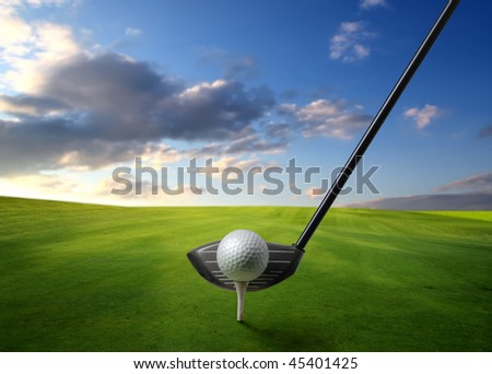 Detail of golf club and ball on a green meadow - stock photo