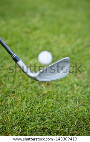 detail of golf rack and ball at golf course - stock photo