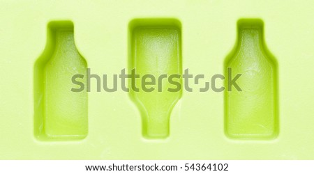 Detail of green ice tray isolated on white background