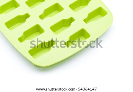 Detail of green ice tray isolated on white background - stock photo