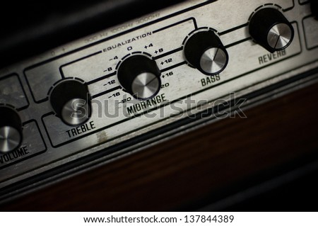 detail of guitar amplifier, knobs - stock photo