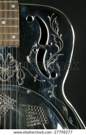 Detail of guitar dobro - stock photo