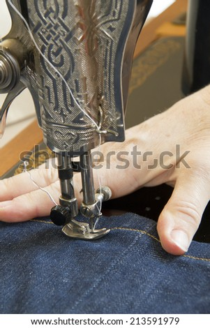 Detail of hand and sewing mashine  - stock photo