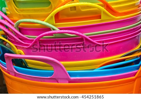 Detail of handles of Colored plastic baskets
