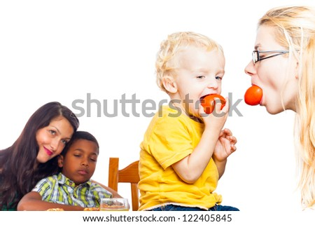 Detail of happy women and children eating tomatoes, isolated on white background with copy space. - stock photo