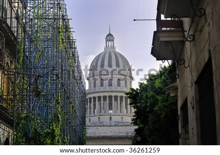Detail of Havana capitol dome with crumbling buildings in the front