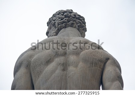 detail of Hercules statue seen from behind - stock photo