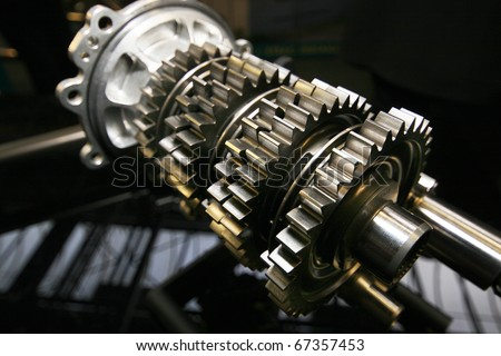 Detail of high performance vehicle gearbox gears on shaft.