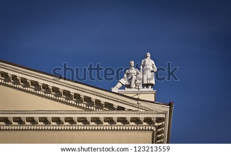 Detail of history building with old sculpture statues in Moscow, Russia - stock photo