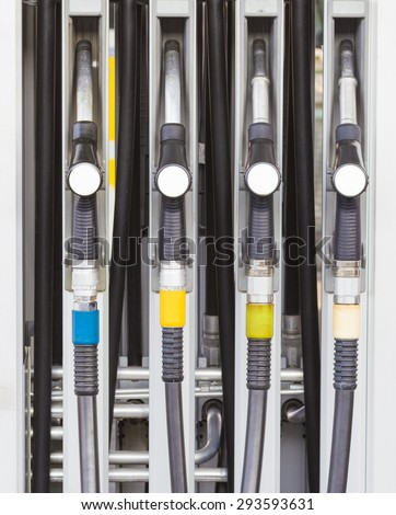 Detail of hoses of petrol pump at a gas station - stock photo