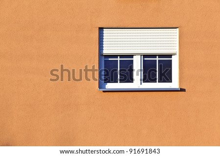 detail of house facade with window - stock photo