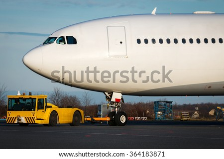 Detail of huge airplane during towing - stock photo