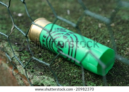 Detail of hunting cartridge lying on the ground - stock photo
