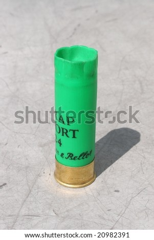 Detail of hunting cartridge standing on the ground - stock photo