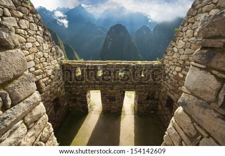 Detail of Inca wall in the ancient city of Machu Picchu, Peru - stock photo