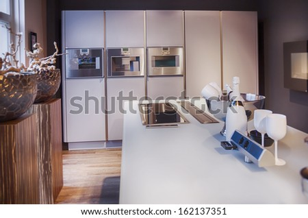 detail of interior of  kitchen with champagne set - stock photo